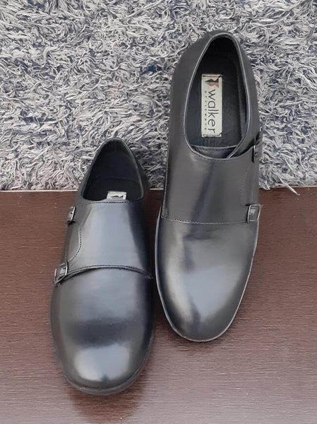 A front view of double monk strap men's large shoes