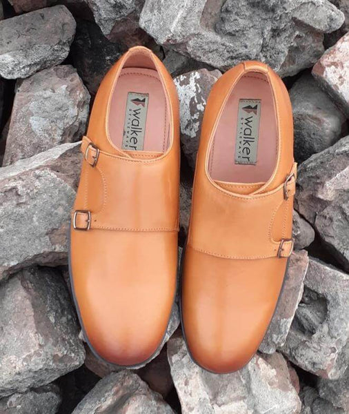 A top view of double monk strap men's broad shoes kept on bricks