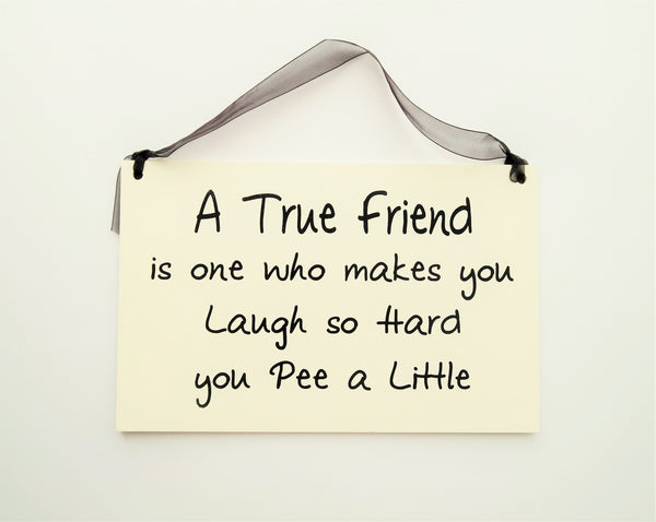 "FUNNY SIGNS: ""A TRUE FRIEND WHO MAKES YOU LAUGH"""