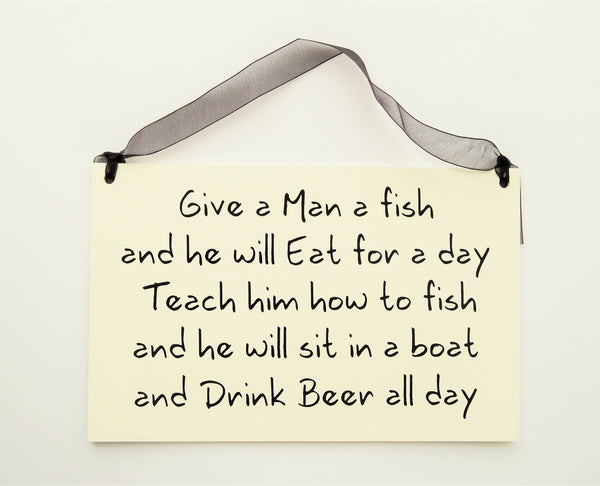 "FUNNY SIGNS: ""GIVE A MAN A FISH"""