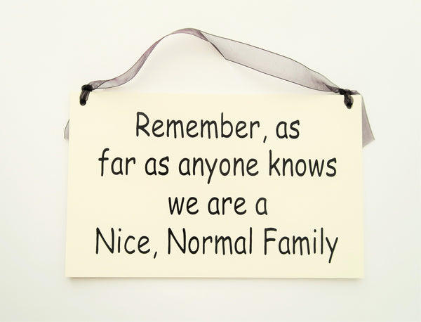 "FUNNY SIGNS: ""NICE, NORMAL FAMILY"""