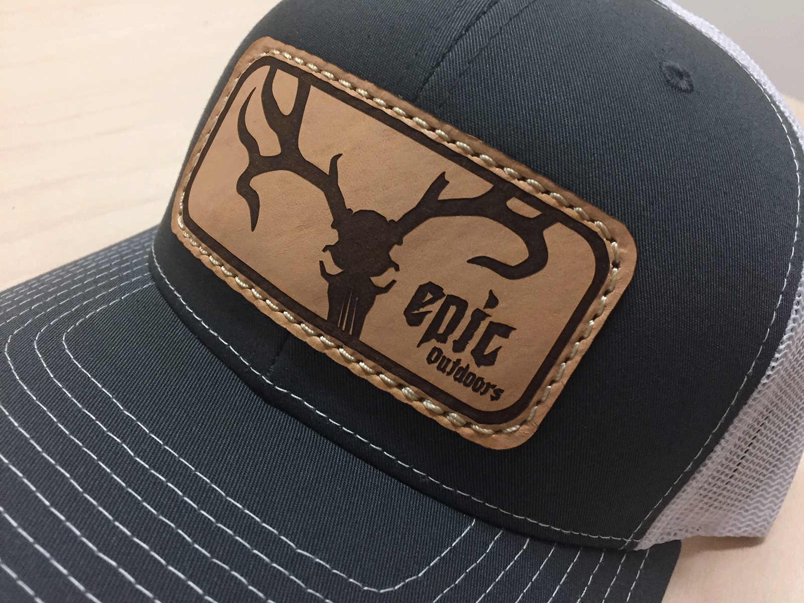 ca33c58d5a3 Epic Outdoors Authentic Leather Patch Trucker Hat