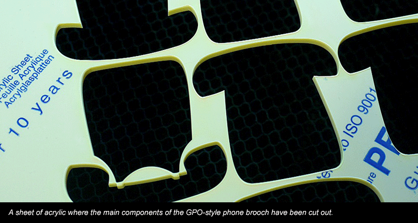 Laser cut sheet of acrylic for GPO-style phone brooches