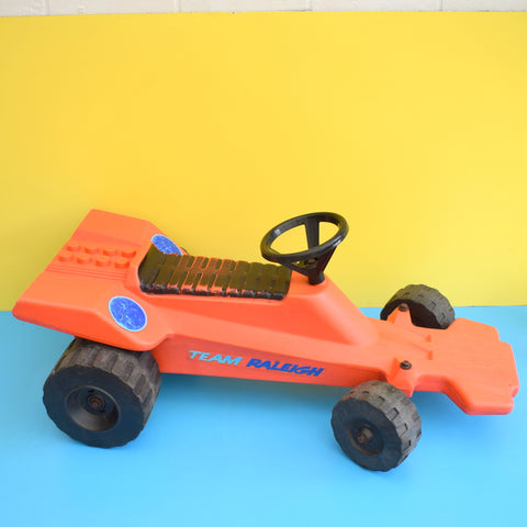 Vintage 1970s Plastic Toy Ride On Team Raleigh Race Car - Orange
