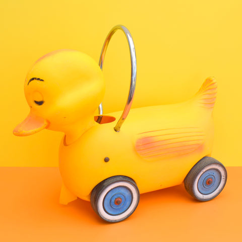Vintage 1960s Kitsch Plastic Ride On Duck With Wheels - Yellow & Chrome