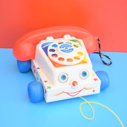 Vintage 1960s kitsch Plastic Fisher Price Chatter Phone Pull Along