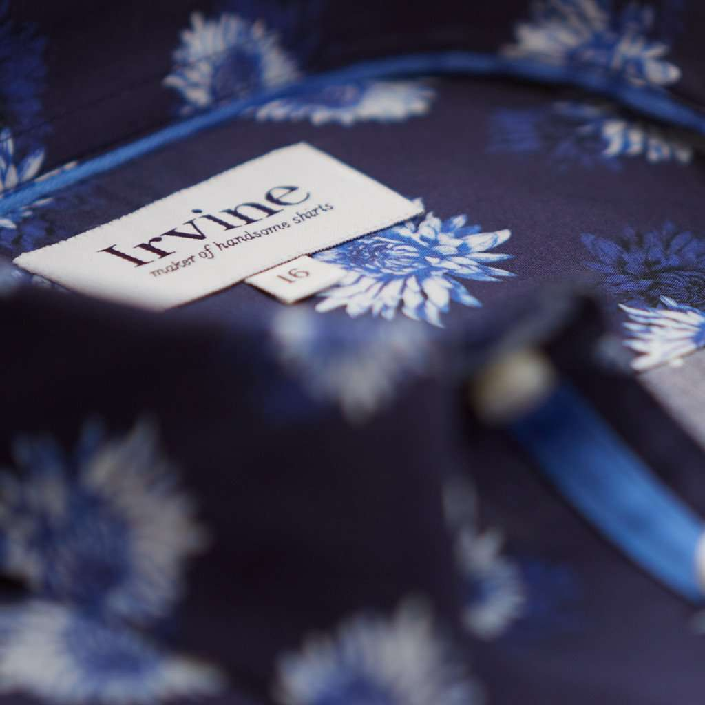 Label of navy blue aster floral shirt