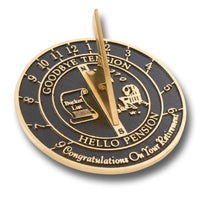 "Retirement Sundial in solid English brass with message that reads  ""GOODBYE TENSION, HELLO PENSION"""