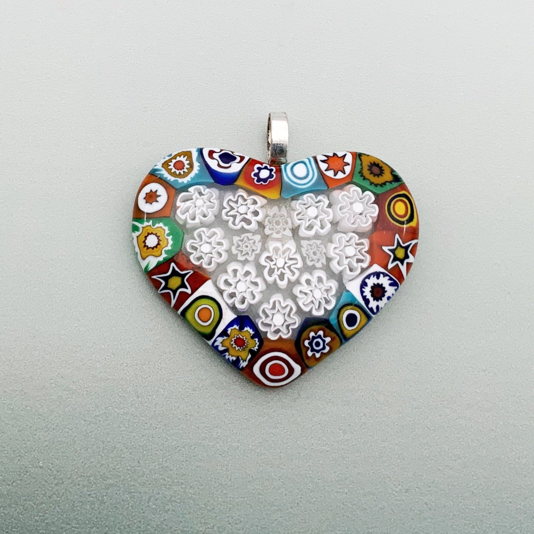 Fused millefiori large glass pendant with opaque patterns and white fleurette