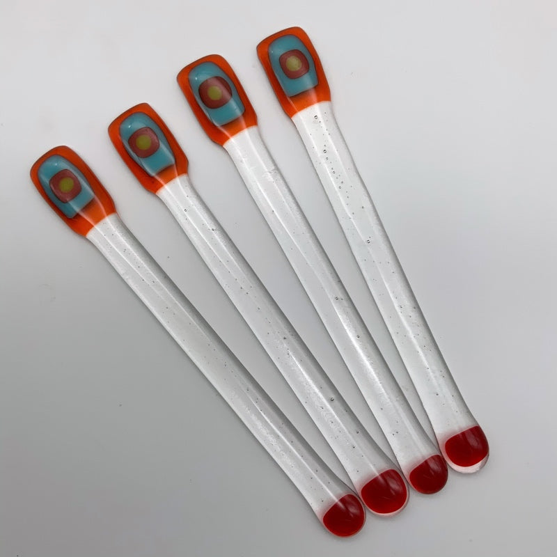 Orange glass swizzle stick