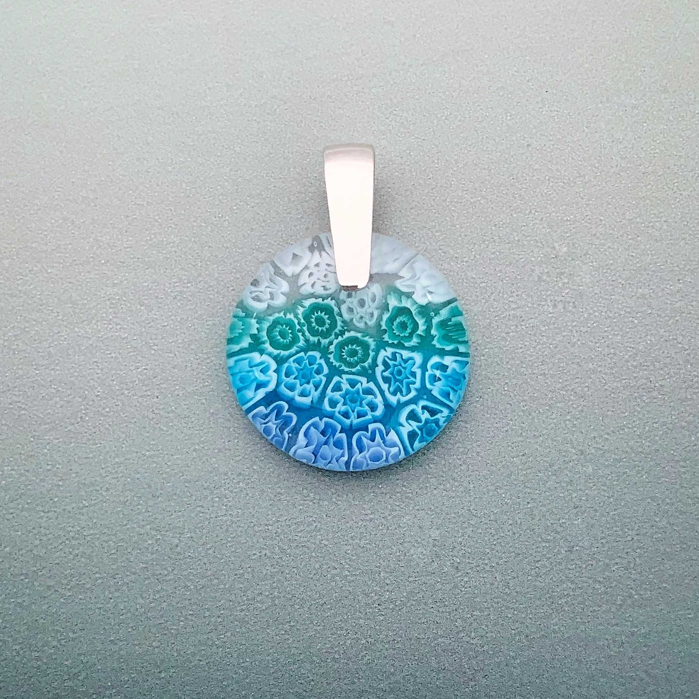 Fused Millefiori glass 24mm round pendant in aqua cascade fleurettes