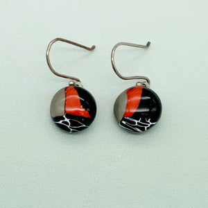 Contemporary round glass dangle earrings in black, red and white