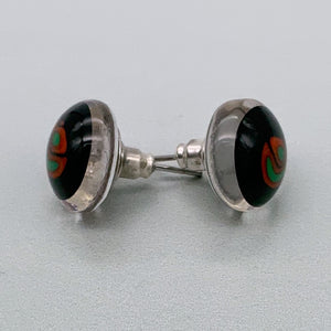 Black stud earrings with green and red glass