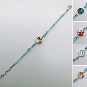 Turquoise bracelets with a mixed selection of glass centers