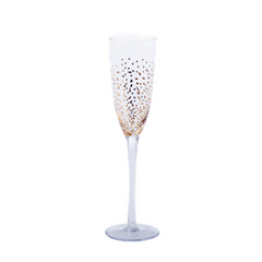 champagne glass with gold dots