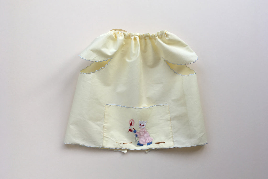 Yellow bib with embroidery - 50% off