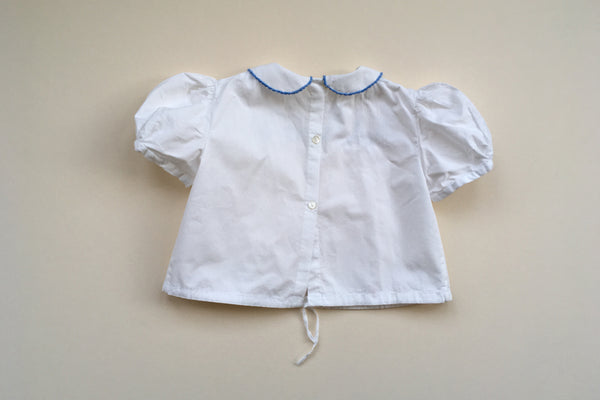 Pretty blouse with blue hand embroidery - 18m