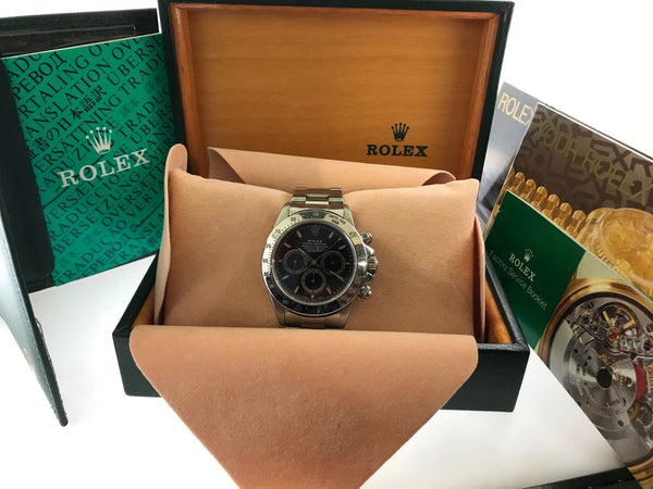 ROLEX DAYTONA SUPERLATIVE CHRONOGRAPH OYSTER PERPETUAL COSMOGRAPH WITH  EXTREMELY RARE DARK PATRIZZI DIAL  $130,000.00 VALUE!