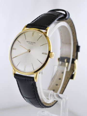 1950's Patek Philippe Calatrava Ref. #2573 Vintage Classic Round Wristwatch with Rare Silver Dial in 18 Karat Yellow Gold - $40K VALUE
