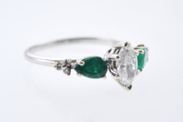 Contemporary Engagement Diamond Ring with Emeralds in Elegant Platinum Setting - $15K VALUE
