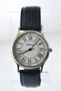 TIFFANY & CO. Elegant Round Stainless Steel Wristwatch on Navy Leather Strap - $3K VALUE