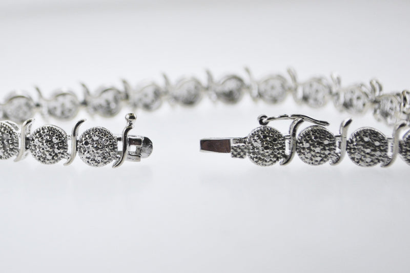 Designer's Diamond Tennis Bracelet Intricate Design Appr. 0.8 TCW in 18 Karat White Gold - $6K VALUE