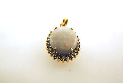 Contemporary Elegant 11 Carat White Opal and 0.50 Carat Diamond Pendant in 18K Yellow Gold - $5K VALUE