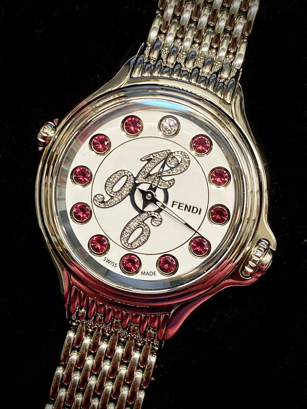 Fendi Crazy Carats w/ with diamonds on the bezel and semi-precious topaz stones as the marker! $12K Appraisal Value w/ CoA!