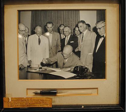 Framed Photograph of President Eisenhower signing Reciprocal Trade Bill with Official Signing Pen - $20K VALUE