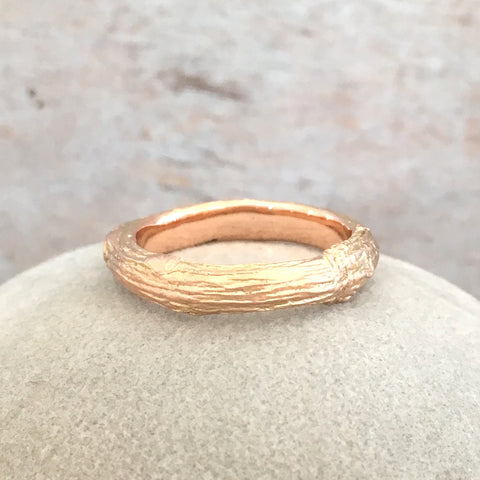 twig ring in 9 carat rose gold with wood grain texture