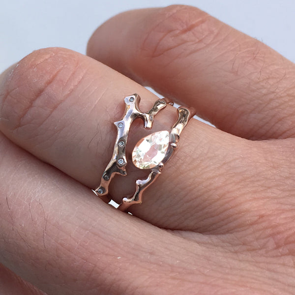 Twig Engagement Ring in 9 carat gold with pear shape white sapphire