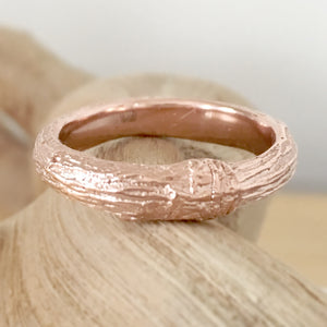 Twig wedding ring for men with woodgrain texture in 9 carat gold