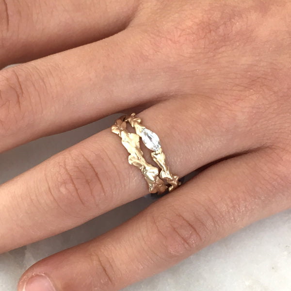 Conifer Leaf Engagement Ring in 9 carat Gold with Marquise Cut Sapphire