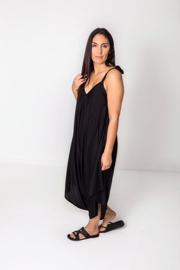 Photo of model wearing NOOZ Bali Jumpsuit, unbelted, in black.