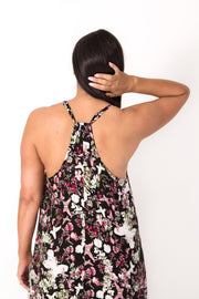 Photo of model showing back detail of NOOZ Black Butterfly Dovetail Dress