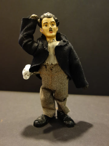 Mechanical CHARLIE CHAPLIN Tin toy with lead head 1925