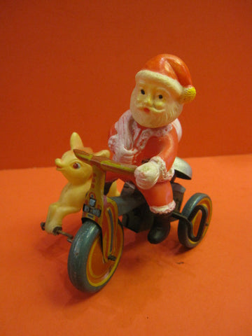 CELLULOID SANTA CLAUS on bike with reinder JAPAN 1946-48