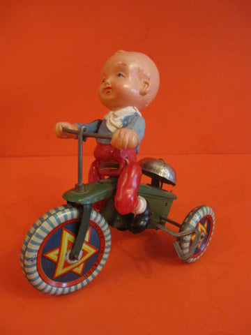 MKT Celluloid boy on Star Tricycle Japan 1930