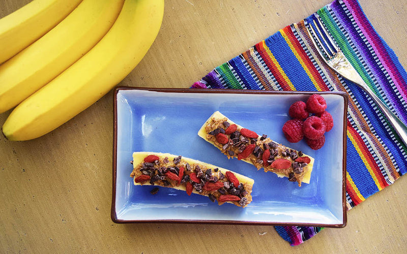 Banana Boat topped with Gojis & Nibs