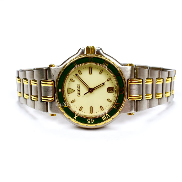 Gucci - 9700M Gold/Steel Green Bezel Watch