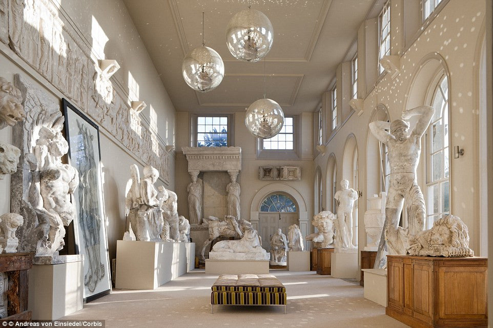 disco balls and priceless greco roman art bizarre interior design trend