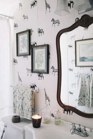 Bringing the outside into your bathroom walls with african animal removable wallpaper