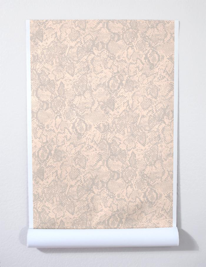 Snakeskin wallpaper roll in peach