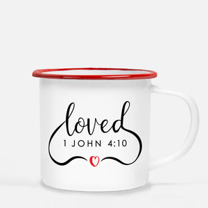 "White enamel 12 oz metal camp mug with red lip | 1 John 4:10 ""Loved"" in flowing script 