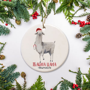 Trauma Llama personalized Christmas ornament.  hand sketched llama in Christmas hat with stethoscope around his or her neck. Perfect for your favorite healthcare hero or new nursing graduate | PIPSY.COM