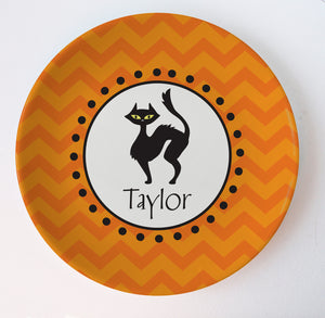 Black cat melamine plate on orange chevrons