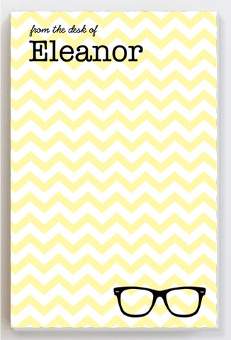 Glasses on a yellow chevron notepad
