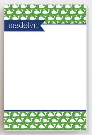 Whales on green with blue banner notepad