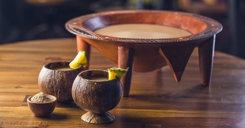 Photo of a bowl of kava and two cups