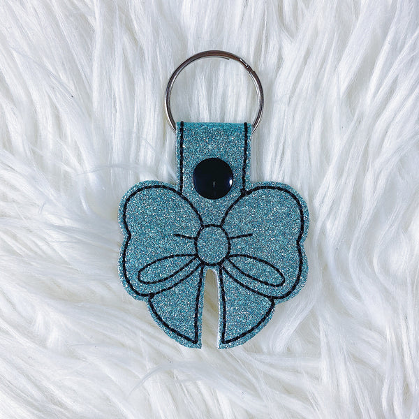 Turquoise Glitter with Black Stitching Bow Feltie Snap-Tab Charm
